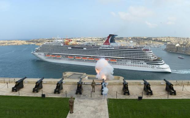 The Carnival Vista cruise liner is given a gun salute as she leaves the Grand Harbour as she continues on her maiden voyage on May 9. Photo: Matthew Mirabelli