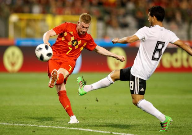 Belgium's Kevin De Bruyne in action with Egypt's Tarek Hamed.
