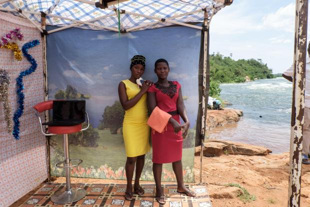 Women pose at a makeshift photo booth during the Nile River Festival 2019 in Jinja.