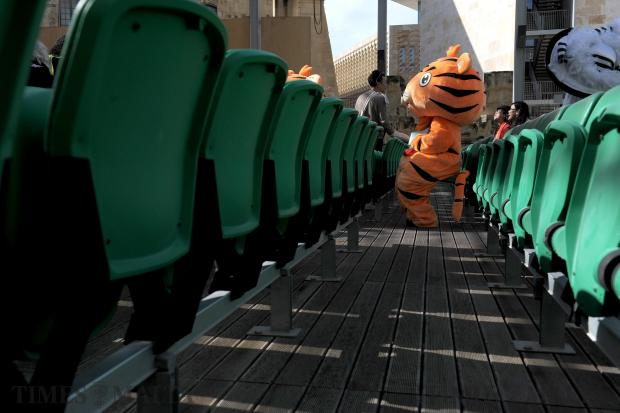 A woman dressed as a tiger watches a performance by the Zhejiang Wu Opera Troupe at the Pjazza Teatru Rjal in Valletta on February 13 to celebrate the Chinese New Year. Photo: Matthew Mirabelli