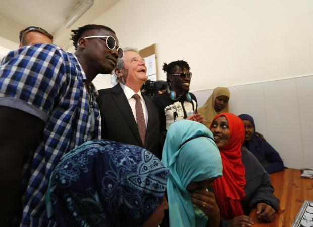 German President Joachim Gauck poses for pictures with migrants during a tour of the Marsa Open Centre for migrants in Marsa on April 30. Gauck was in Malta on a two-day state visit, during which he is also meeting with migrants and NGOs working with migrants. Photo: Darrin Zammit Lupi