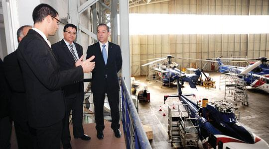 From left: Malta Enterprise chairman Alan Camilleri, Finance Minister Tonio Fenech and Prime Minister Lawrence Gonzi at Medavia's present hangar from where it will migrate soon to new premises nearby. Photo: DOI