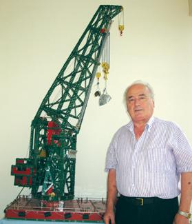 Joseph N. Attard with the model crane in its elevated position.