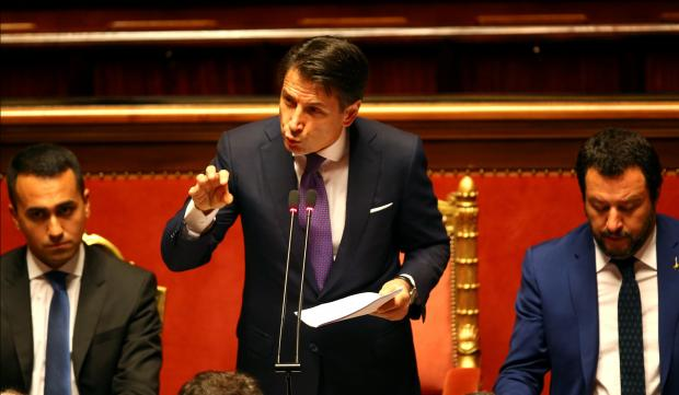 Newly appointed Italian Prime Minister Giuseppe Conte speaks next to Interior Minister Matteo Salvini and Minister of Labor and Industry Luigi Di Maio.