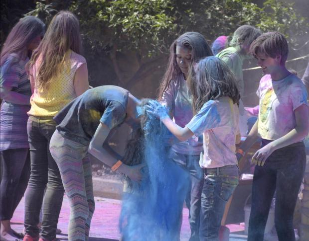Girls try to take off blue powder from another girl's hair at the feast of Holi in St Venera on March 31. PHOTO: MARK ZAMMIT CORDINA.