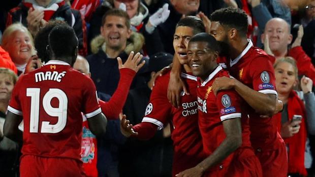 Liverpool's Roberto Firmino celebrates scoring their first goal with Sadio Mane, Georginio Wijnaldum and team mates.