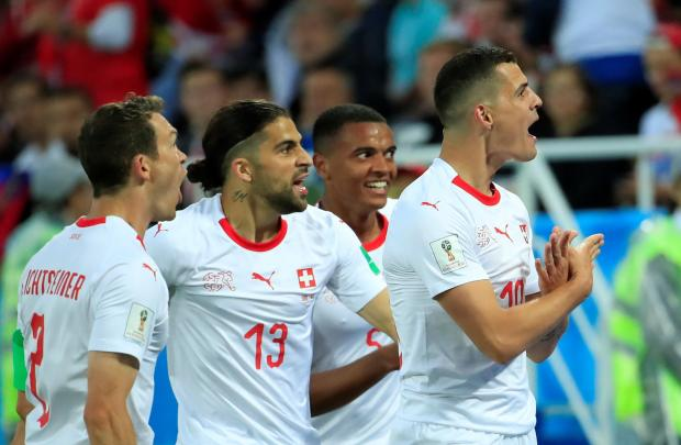 Granit Xhaka celebrates his goal against Serbia. Photo: Reuters