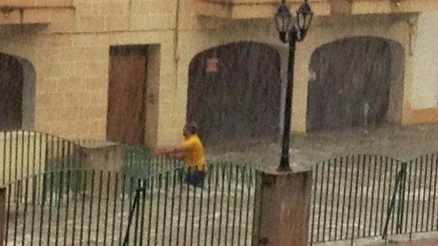 "A man struggles against the water in Msida this afternoon. Photo Diane Pillow. <a href=""mailto:mynews@timesofmalta.com"" target=""_blank"">mynews@timesofmalta.com</a>"
