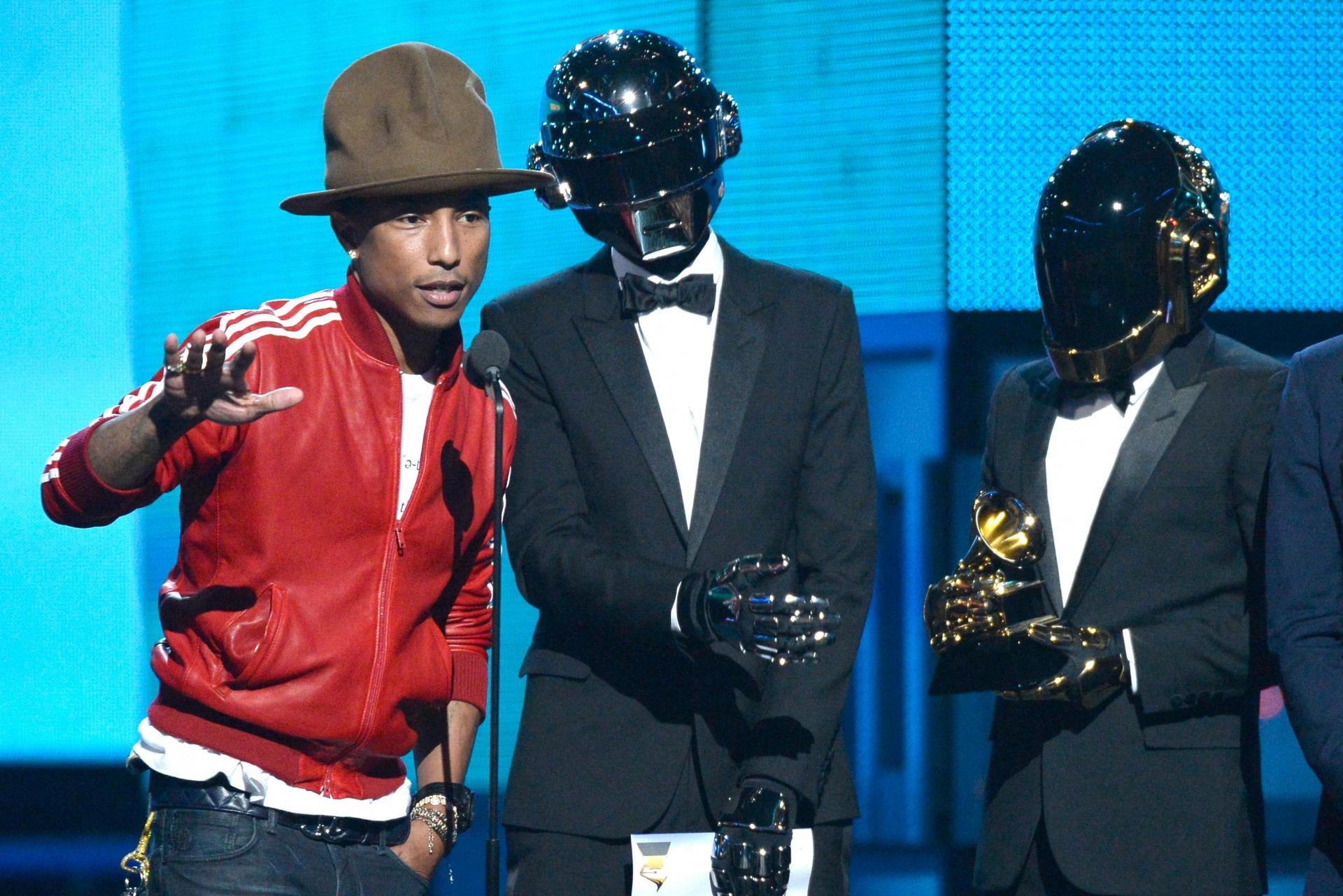 In this file photo taken on January 26, 2014 (left to right) musicians Pharrell Williams, Thomas Bangalter, and Guy-Manuel de Homem-Christo of Daft Punk accept the Best Pop Duo/Group Performance award for 'Get Lucky'. Photo: Kevork Djansezian/Getty Images North America/AFP