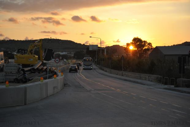 The sun sets on the stretch of road between Bugibba and the junction to t'Alla u Ommu on January 8, just before it was closed for service works for a week. Photo: Jason Borg