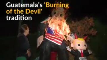 Guatemalans burn Trump effigies to scatter evil spirits