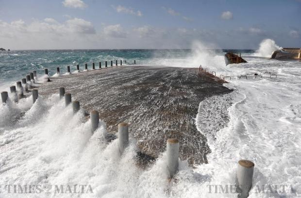 Waves batter the quay at Cirkewwa on February 18. Photo: Chris Sant Fournier