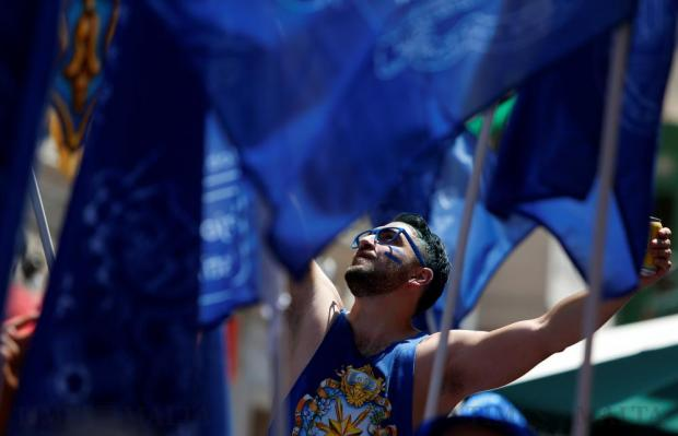 A reveller takes part in a village band march during celebrations marking the feast of the Assumption of Our Lady in Mosta on August 15. Photo: Darrin Zammit Lupi