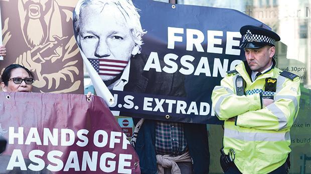 Supporters of Julian Assange gather outside Westminster Magistrates Court where the WikiLeaks founder appears in custody following his arrest on April 11 in London, England. Photo: Wiktor Szymanowicz/Nurphoto