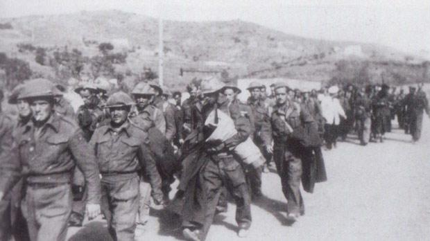 British POWs en route to Lakki. Some of the POWs still have the Malta rubble wall camouflage on their steel helmets.