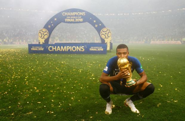 France's Kylian Mbappe celebrates with the trophy after winning the World Cup.