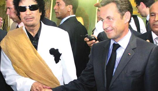 Libyan President Muammar Gaddafi in a recent meeting with French President Nicolas Sarkozy.
