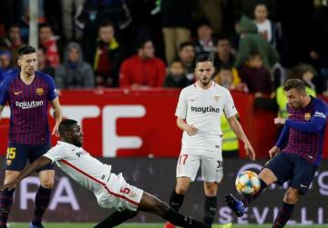 Barcelona left with mountain to climb after cup defeat by Sevilla