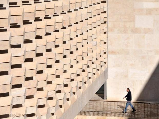 A man walks past Parliament House in Valletta on January 29. Almost two-thirds of the stone cut from a Qala quarry to clad the new Parliament building in Valletta failed rigorous tests and a safety certification cannot be issued. Photo: Chris Sant Fournier