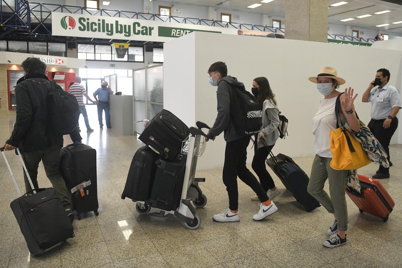 Tourists arrive at Malta International Airport as the tourist season opens, quietly. Photo: Matthew Mirabelli