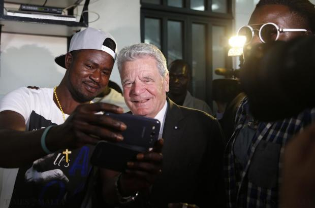A migrant takes a 'selfie' with German President Joachim Gauck at the Marsa Open Centre for migrants in Marsa on April 30. Gauck was in Malta on a two-day state visit, during which he is also meeting with migrants and NGOs working with migrants. Photo: Darrin Zammit Lupi