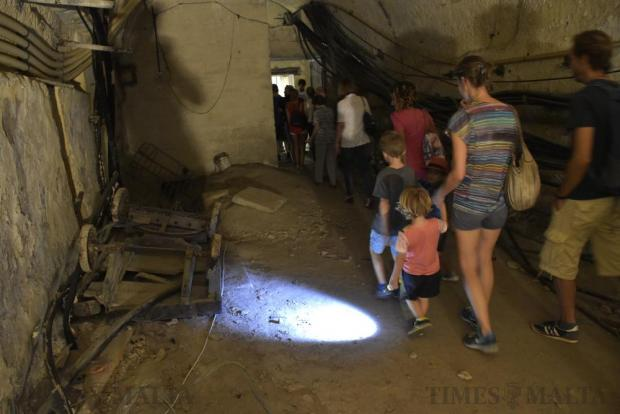 Visitors walk through a tunnel forming part of the old Malta Railway which was closed down in 1931 in Floriana on October 9. Locals and tourists flocked to see part of the network of tunnels during an open day. Photo: Mark Zammit Cordina