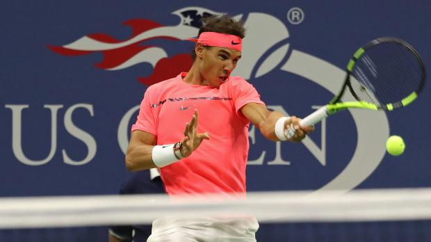 Rafael Nadal of Spain hits a forehand against Andrey Rublev of Russia.