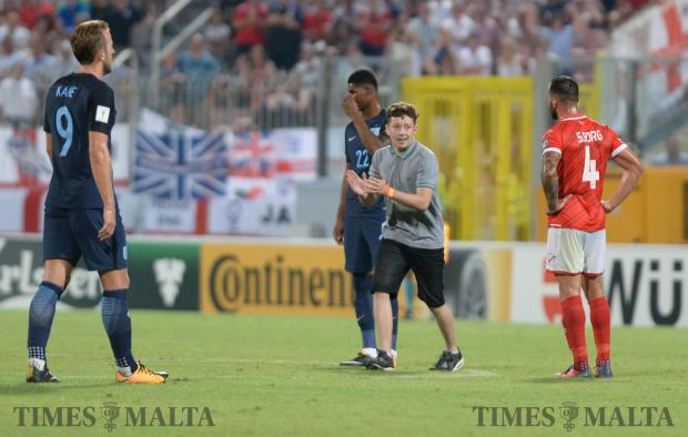 A fan runs onto the pitch during Malta's FIFA 2018 World cup Qualifying Group F Match against England at the National Stadium in Ta'Qali on September 1. Photo: Matthew Mirabelli