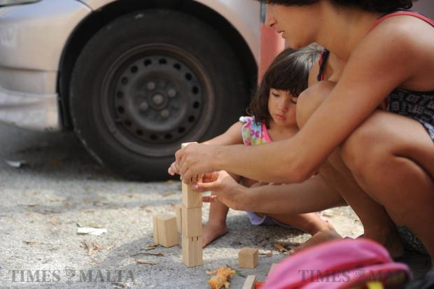A child plays with wooden blocks in front of the ERA offices in Floriana as demonstrators gathered in protest over the controversial decisions taken on August 26. Photo: Steve Zammit Lupi