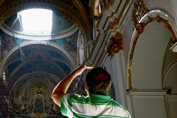 A man looks at the hole in the ceiling of the Ta' Ġieżu church in Rabat after the collapse on August 26. Photo: Jonathan Borg