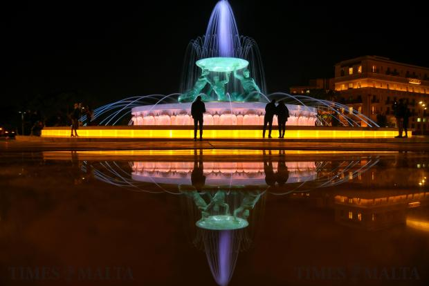 People admire the Triton Fountain at the entrance to Valletta on February 22 Photo: Jonathan Borg