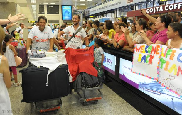 Members of the Actavis Life cycle challenge arrive at Malta International Airport on September 1, after completing the 2000km cycle challenge across Russia raising money for the Renal Unit at Mater Dei Hospital. Photo: Matthew Mirabelli