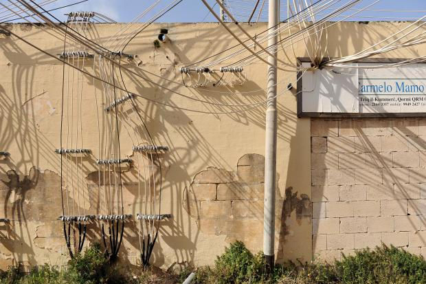 Wires clad a wall at the old Trade Fair grounds in Naxxar on April 26. Photo: Chris Sant Fournier