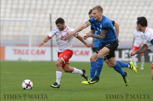Malta's Luke Gambin (left) tries to make his way past the Estonian defence during their International friendly match at the National Stadium in Ta'Qali on November 12. Malta lost the match 3-0. Photo: Matthew Mirabelli
