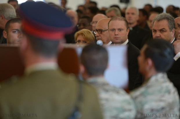 Prime Minister Joseph Muscat watches as the bodies of twenty-four migrants who were among 850 feared dead in the Mediterranean on Saturday night are laid in a tent on the helipad at Mater Dei Hospital on April 23. Photo: Matthew Mirabelli