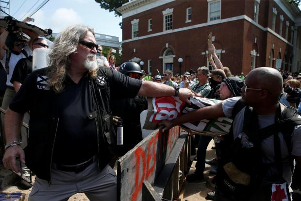 A white supremacist grabs a counter-protester in Virginia. Photo: Reuters