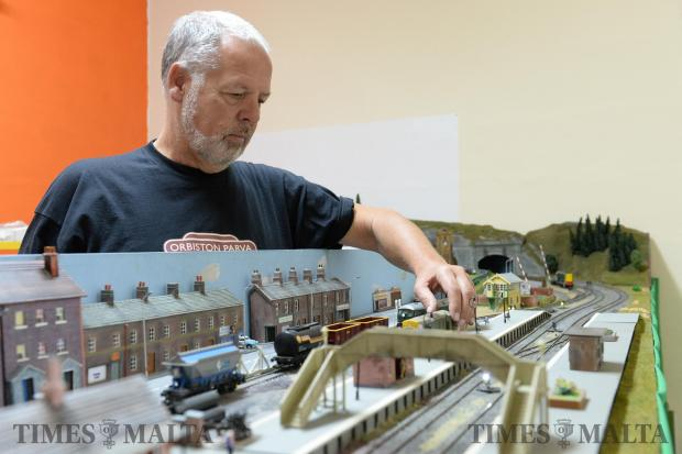 A member of the Model Railways Group tinkers with his model of a British train station, at their premises in Paola on December 17. Photo: Matthew Mirabelli