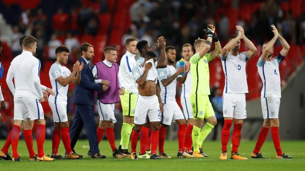 England players applaud fans after the game.