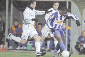 Marsaxlokk`s new recruit Chucks Nwoko (right) running clear from Stefan Giglio.