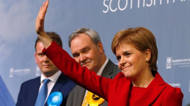 Scotland's First Minister and SNP leader Nicola Sturgeon acknowledges her supporters after winning her seat at a counting centre in Glasgow.