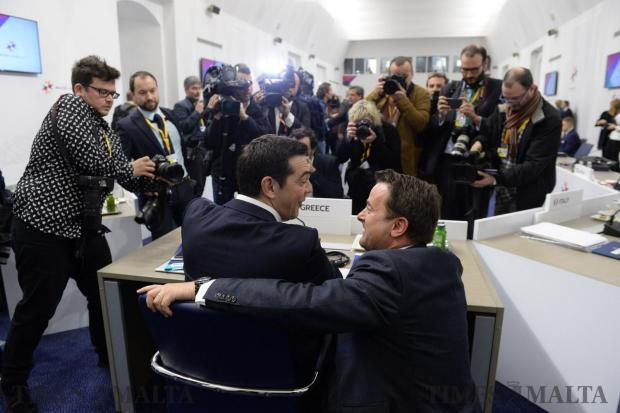Greek Prime Minister Alexis Tsipras (L) jokes with Prime Minister of Luxembourg, Xavier Bettel during an Informal summit of EU heads of state or government on February 3, 2017 in Valletta. Photo: Matthew Mirabelli