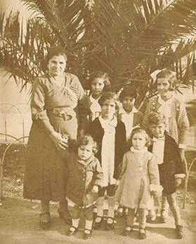 Karmena Calleja with her children in Floriana in 1933. She shared her experiences of World War II in Malta.
