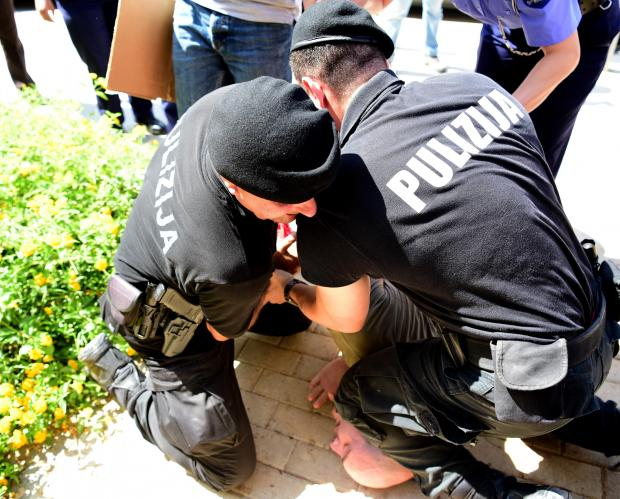 An activist is pinned down by the police. Photo: Mark Zammit Cordina