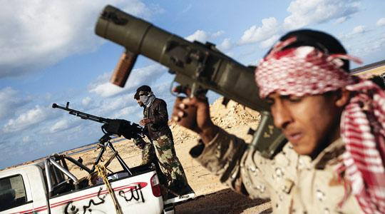 Libyan rebel fighters standing ready with anti-aircraft weapons at a checkpoint on the outskirts of Ras Lanuf, yesterday. Photo: Marco Longari/AFP