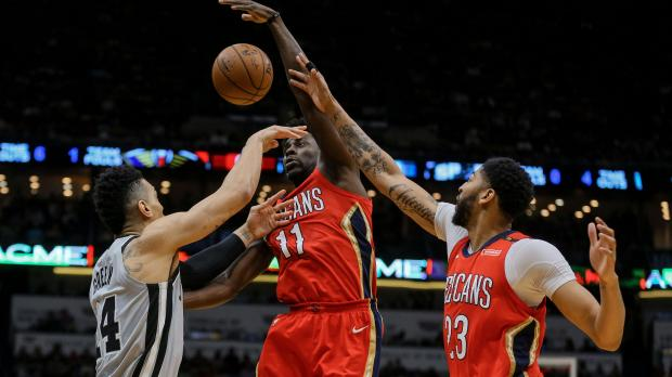 New Orleans Pelicans guard Jrue Holiday (11) and forward Anthony Davis (23) defend against San Antonio Spurs guard Danny Green (14) during the second half at the Smoothie King Center. The Pelicans defeated the Spurs 122-98. Photo Credit: Derick E. Hingle-USA TODAY Sports