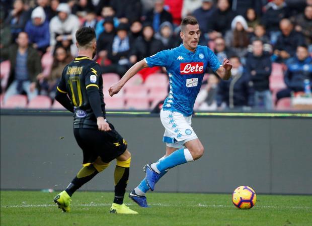 Napoli's Arkadiusz Milik in action with Frosinone's Francesco Zampano