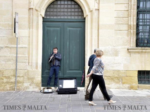 A busker plays a musical instrument in Merchants Street, Valletta on January 28. Photo Mark Zammit Cordina
