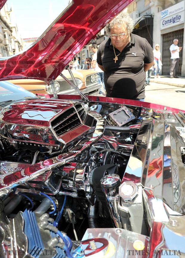 A man admires the polished chromed engine of a car at the Hamrun Car Show on May 28. Photo: Chris Sant Fournier