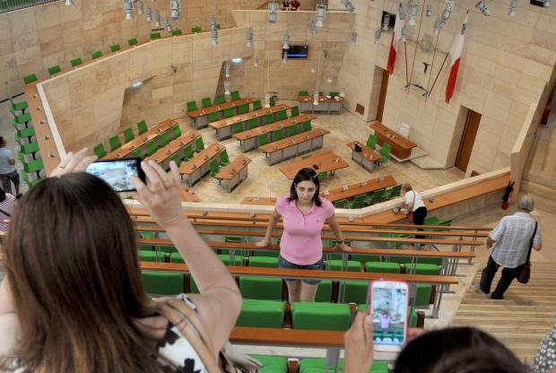 People at the Parliament open day capture an image of the main chamber on June 6. Photo: Chris Sant Fournier