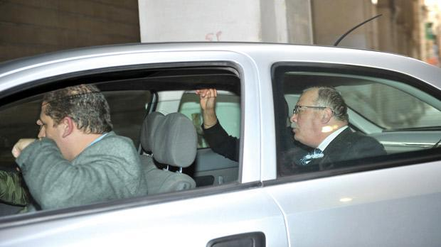 Judge Pace (in rear seat) being taken to court on Thursday.